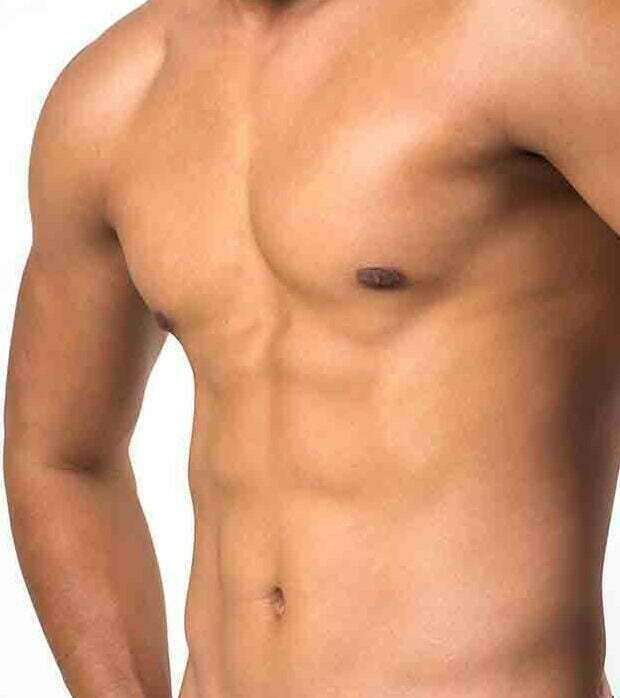 Muscular man showing six pack abs isolated on white background.